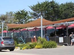the glass enclosed patio at moonstone beach bar u0026 grill picture