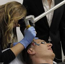pictured man with mitt romney face tattoo begins laser surgery to