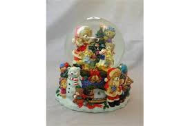 large musical snow globe with teddy bears around