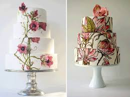 wedding cakes adorned with colorful flowers and butterflies for