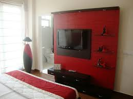 modern black and red bedroom with grey bed sheet and rug carpet