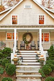 Fall Decorated Porches - front porch fal decor deborah herbertson via country living