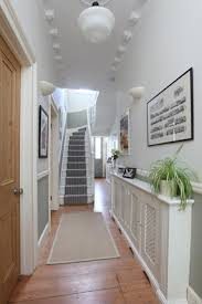 entering into the narrow hallway the palest of taupe paints above