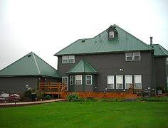 gaf elk hunter green shingles this roof has some color but still