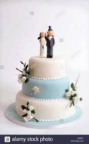 Decorative Flowers by A Three Tier Wedding Cake With Decorative Flowers And Comic Bride