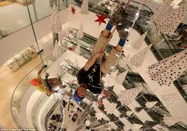 john lewis christmas decorations are put up at london store 79