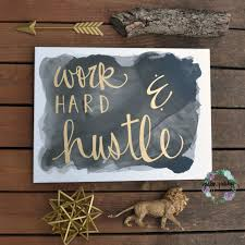 black and gold u201cwork hard and hustle u201d canvas art