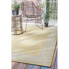 traditional modern indoor and outdoor yellow porch rug