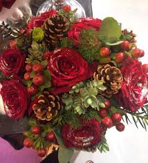 Foliage Flower - christmas wedding flowers in a brides hand tied bouquet of