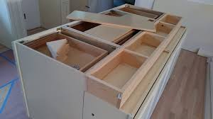 how to make a kitchen island using cabinets how to build and make a sided kitchen island from wall cabinets diy kitchen island ideas