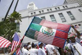 Mexicans Flags Mexican Flag Is Superimposed Over American Flag In Front Of City