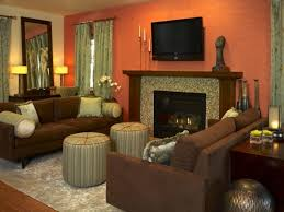 sage green fireplace with orange wall color for traditional family