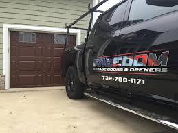 garage door installation repair service in toms river freedom 8 x 7 chi 2701 fiberglass door walnut finish with monticello designer glass
