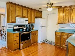 white kitchen cabinets with green countertops how to make your own marble countertops remodeled