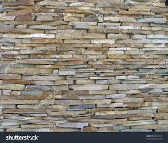 stone heap textured wall construction background stock photo