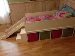 Platform Bed With Storage Building Plans by Diy Toddler Bed With Small Slide And Toy Storage Diy Toddler