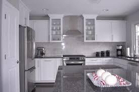 dark grey countertops with white cabinets white cabinets grey granite www looksisquare com