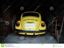 yellow volkswagen beetle royalty free yellow beetle in garage stock image image of house retro 4553943