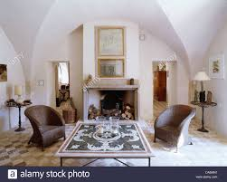 country livingroom furniture comfortable home design pair of wicker chairs either side of fireplace in french country
