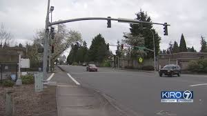 red light ticket video bellevue traffic cameras issue twice as many infractions as officers