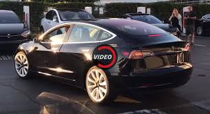 tesla releases video of first production spec model 3