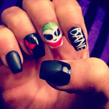 here are my halloween harley quinn nails done by vikki complete