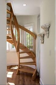 wooden spiral staircase and wall decor decorating ideas around