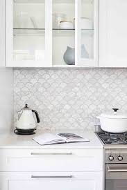 what is the best backsplash for a white kitchen 14 white marble kitchen backsplash ideas you ll