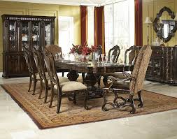 9 piece dining set with upholstered host chairs by legacy classic