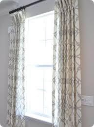 geometric custom drapes white trellis brown and iron gates
