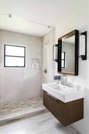 decorating with glass to stretch small bathrooms visually 35