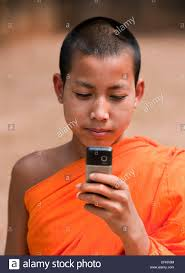 novice buddhist monk in saffron robe from village near the mekong