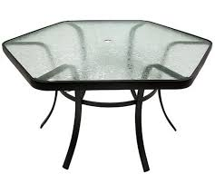 hexagon patio table and chairs one in stock hexagon glass patio table 62 w x 29 5 h sold