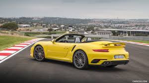 porsche turbo convertible 2016 porsche 911 turbo cabriolet color racing yellow rear