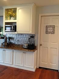 honey oak cabinets painted white with faux tin backsplash my