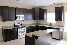 colors for a kitchen with dark cabinets dark cabinets light countertops backsplash what color wood floor