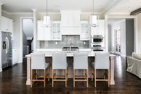 taupe kitchen island with dove gray counter stools transitional