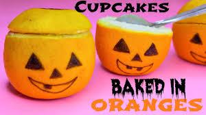 Diy Halloween Treats Jack O Lantern Cupcakes Baked In Oranges Diy Halloween Treats
