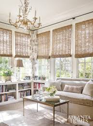 neutral half wall corner bookcase woven window shades ornate