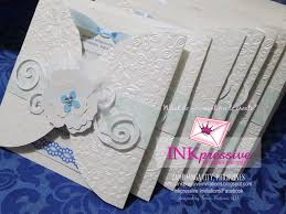 wedding invitations embossed handmade at its best wedding invitation embossed feathers