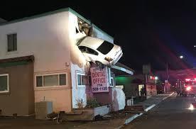 2 floor house car flies into 2nd floor of santa building orange county