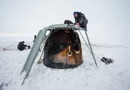 unpacking cargo from expedition 38 soyuz landing nasa