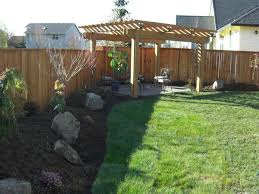 backyard landscaping with wooden pergola and wooden fences nice