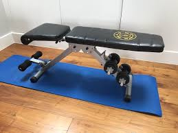gold gym weights bench with weights in east finchley london