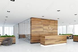 Wood Reception Desk Side View Of A Wooden Reception Desk Standing In An Open Space