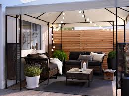 Ikea Outdoor Light A Patio With Two Sofas And A Table In Black Brown Plastic Rattan