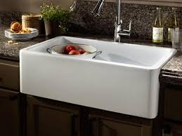 solid surface farmhouse sink farmhouse fast fix kohler adds top mount self trimming apron with