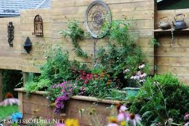 How To Build A Large Raised Garden Bed - diy raised garden bed with built in privacy wall empress of dirt