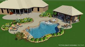 pool and spa with rock waterfall and accents outdoor kitchen with
