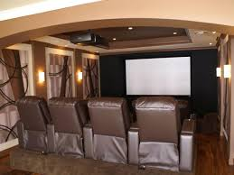 basement home theater with wainscoting and wall decor creating a